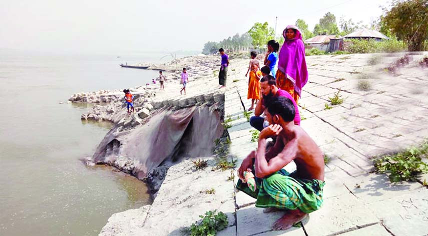 Local people being panicked as major portion of Jamuna River bank, washed away due to sudden erosion. This photo was taken from Khaskawlia area under Chowhali upazila of Siraganj district on Saturday.
