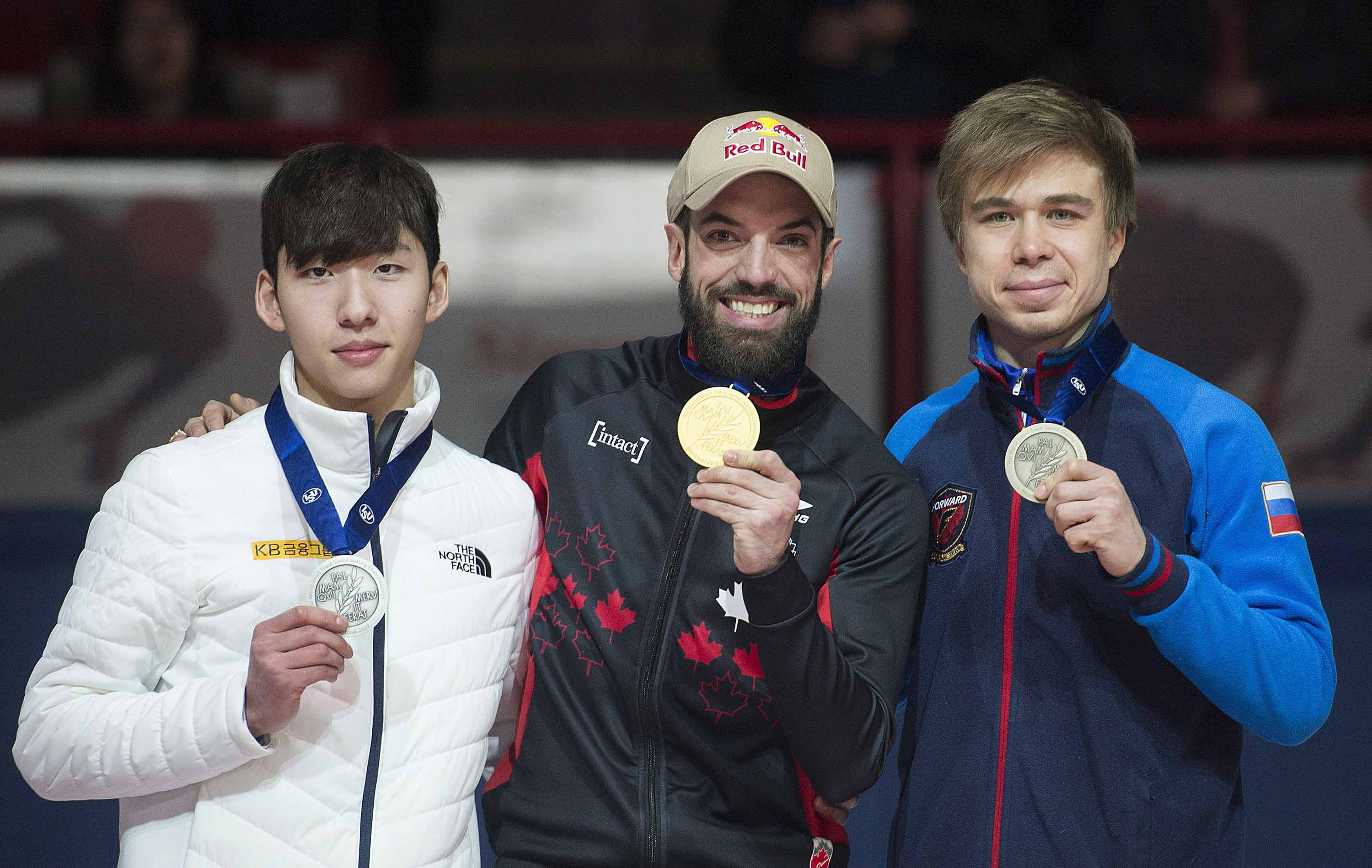 From left :  Lim Hyo-jun of South Korea (silver), Charles Hamelin of Canada (gold) and Semion Elistratov of Russia (bronze) hold up their medals following the men's 1,500 meters at the ISU world short-track speedskating championships in Montreal on Saturday.