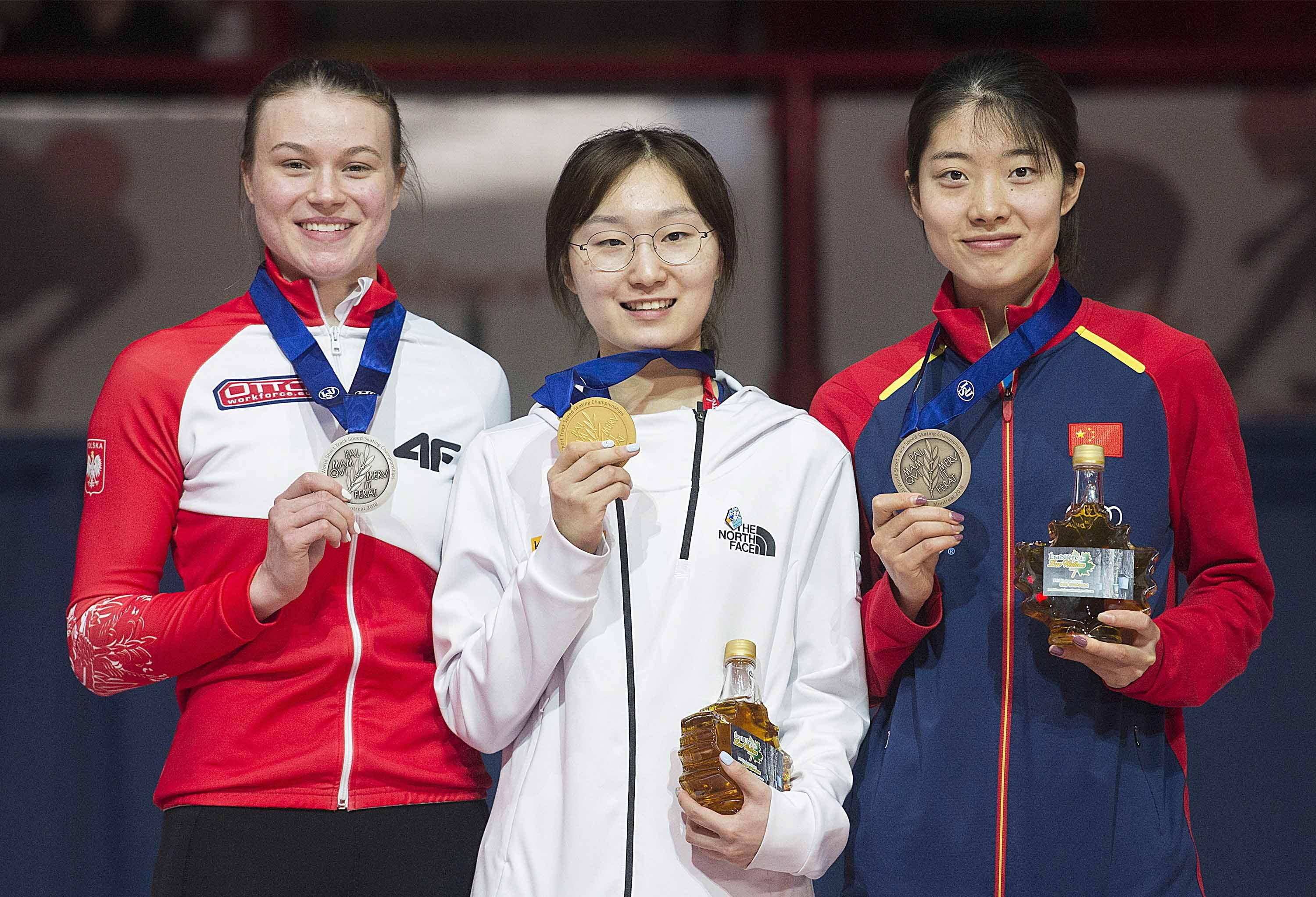 From left: Natalia Maliszewska of Poland; Choi Min-jeong of South Korea and Qu Chunyu of China hold up their medals following the women's 500 meters at the ISU world short-track speedskating championships in Montreal on Saturday.