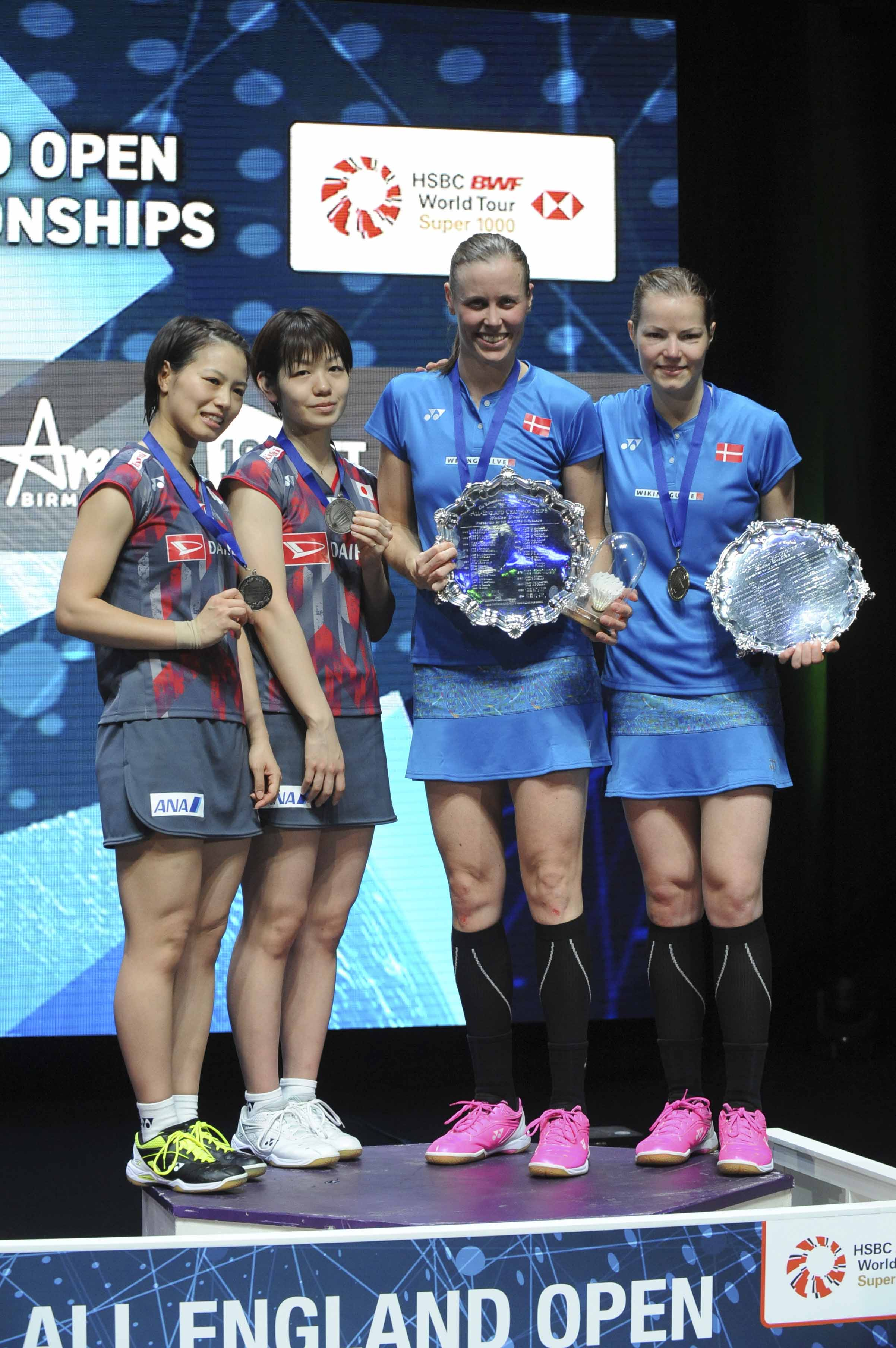 Winners Denmark's Kamilla Rytter Juhl and Christinna Padersen (right) pose on the podium with second placed Japan's Yuki Fukushima (left) and Sayaka Hirota after the women's doubles final match at the All England Open Badminton tournament in Birmingham, England on Sunday.