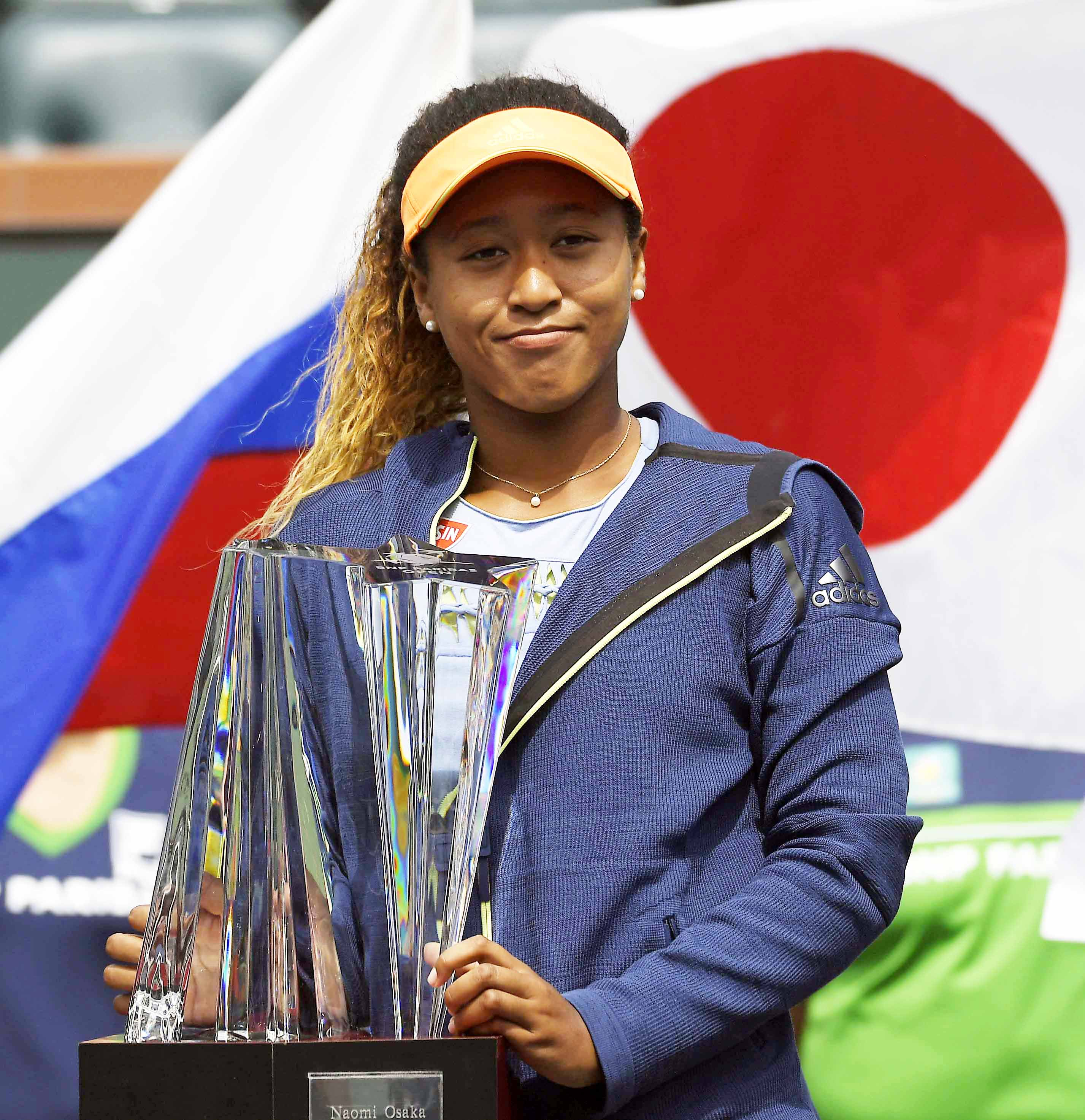Naomi Osaka of Japan poses with her trophy after defeating Daria Kasatkina of Russia in the women's final at the BNP Paribas Open tennis tournament on Sunday in Indian Wells, Calif. Osaka won 6-3, 6-2.