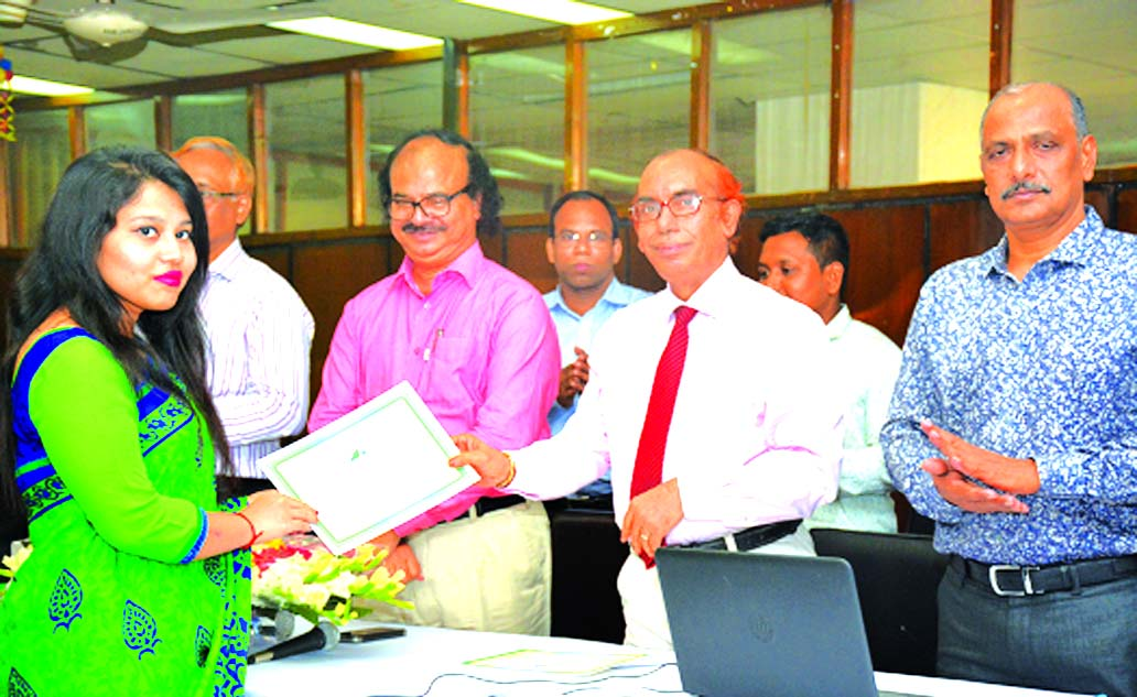 Professor Dr. Mijanur Rahman, Vice-Chancellor of Jagannath University, handing over the certificate among the participants of a six-day long special workshop on