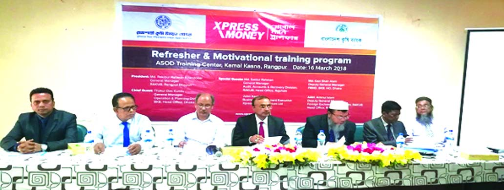 Md. Rakibur Rahman Khandokar, General Manager of RAKUB, presiding over the 'Motivational and Refreshers Training Programme' for its remittance officers jointly organized by Bangladesh Krishi Bank (BKB) and Xpress Money at a local training centre in Rangpur recently. Kazi Shah Alam, DGM of Foreign Remittance Management Department of BKB and Jhulan Kanti Das, Business Development executive of Xpress Money to Bangladesh among others were also present.