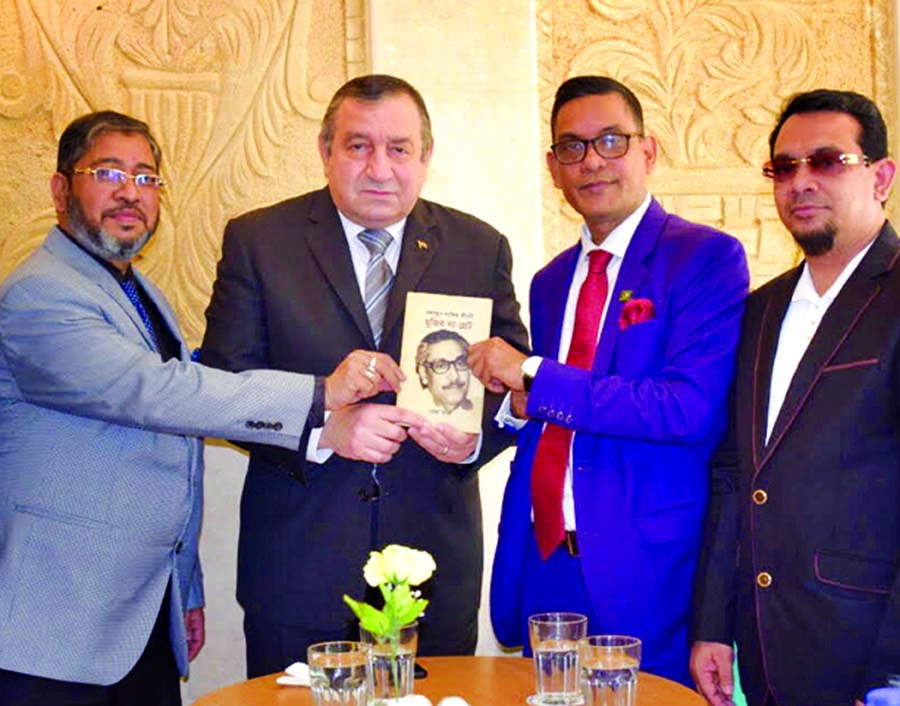 A delegation of Bangladesh-Egypt Friendship Association (BEFA) presenting a book on Father of the Nation Bangabandhu Sheikh Mujibur Rahman to former Prime Minister of Egypt Prof. Dr. Essam Sharaf (2nd from left) at a function held in a Cairo hotel recently. BEFA President Advocate Faisal Reza (left), Better Bangladesh Foundation (BBF) Chairman and Founder Masud A Khan (2nd from right), Hossain Mazumder (extreme right), Director of BBF and Vice President of BEFA and also owner of Ali Air Travels joined the programme.