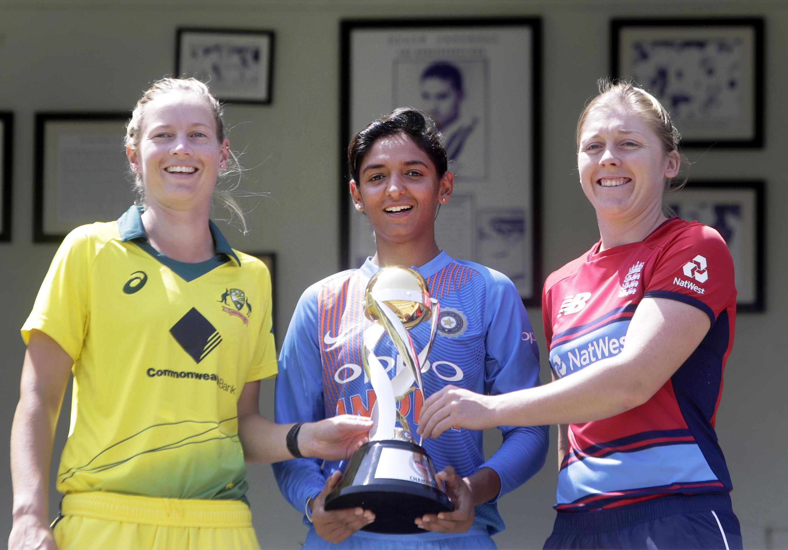 (From left to right) Australia's team captain Meg Lanning, India's team captain Harmanpreet Kaur and England's team captain Heather Knight pose with the Paytm Women's Tri-Series trophy in Mumbai, India on Wednesday.