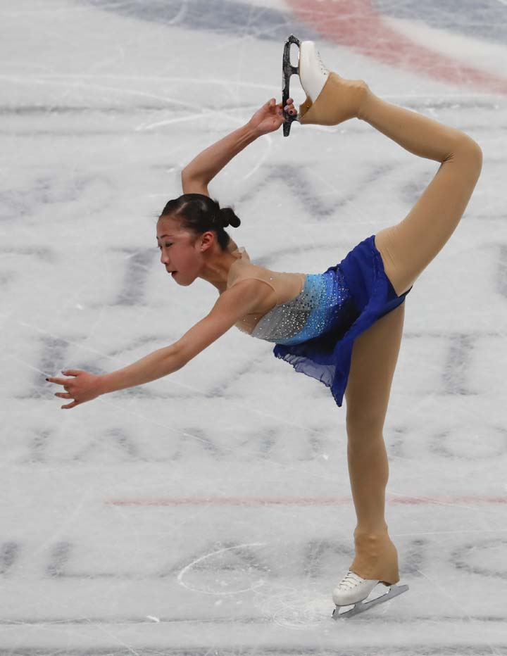 Xiangning Li of China performs during women's short program at the Figure Skating World Championships in Assago, near Milan on Wednesday.
