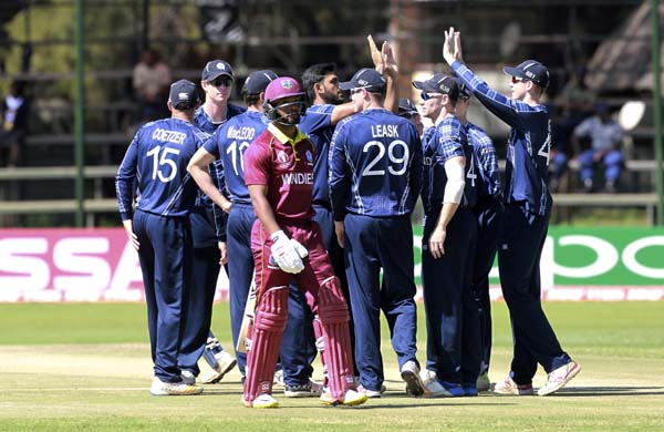 Scotland players celebrate the wicket of West Indies batsman Shai Hope during their cricket World Cup qualifier match at Harare Sports Club on Wednesday. Zimbabwe is playing host to the 2018 Cricket World Cup qualifier matches featuring 10 countries.
