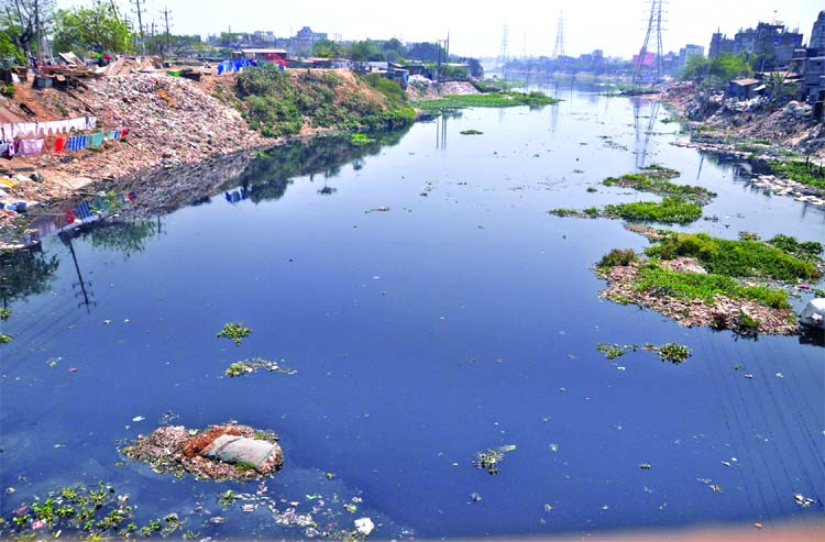 Encroachers illegally occupying the major portion of both sides of once mighty tributaries of Buriganga River. But the authorities concerned kept their eyes shut to take any steps to restore the losing parts and its beautification. This photo was taken from the city's Islambagh on Wednesday.