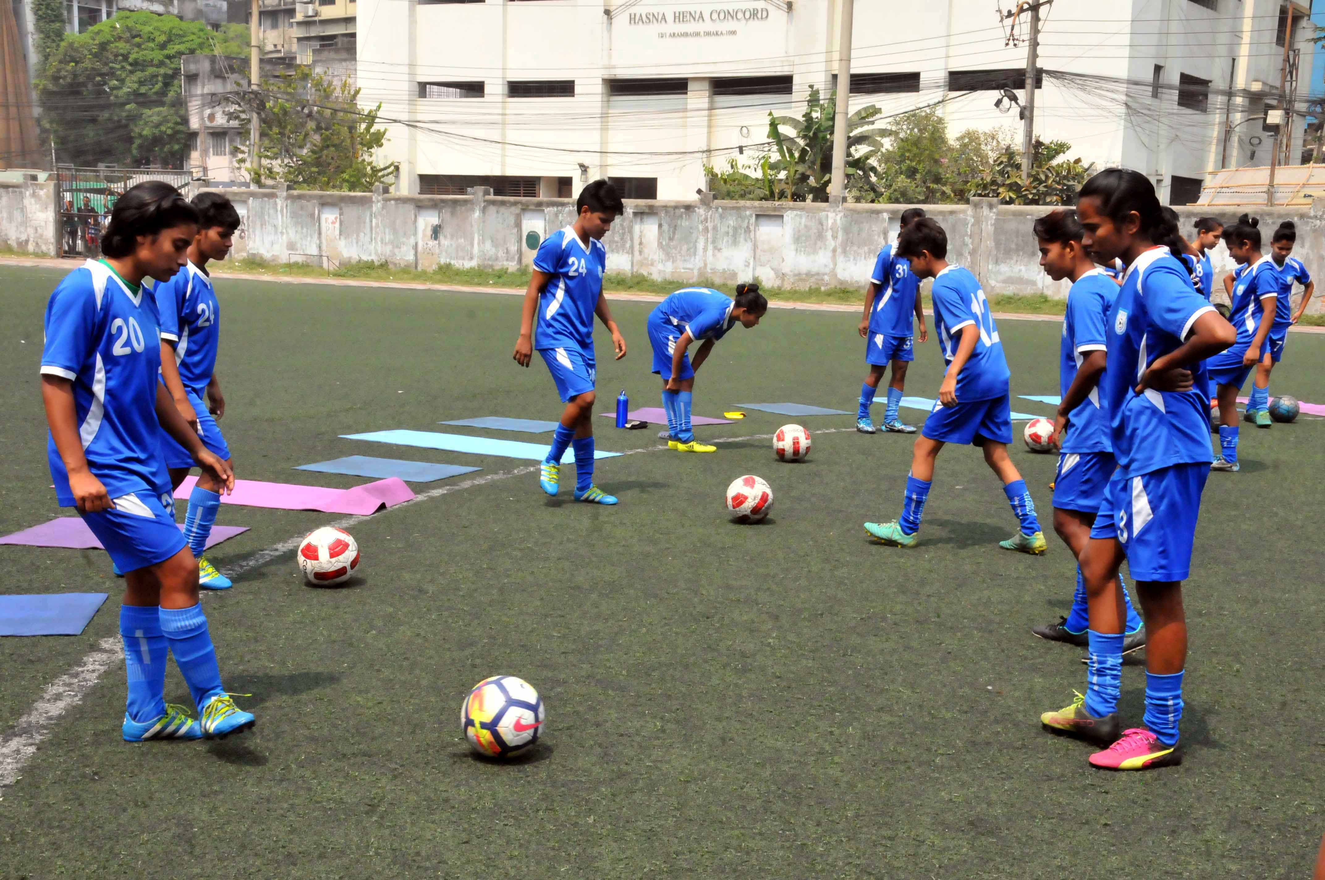 Members of Bangladesh National Under-16 Women's Football team during their practice session at the BFF Artificial Turf on Thursday.