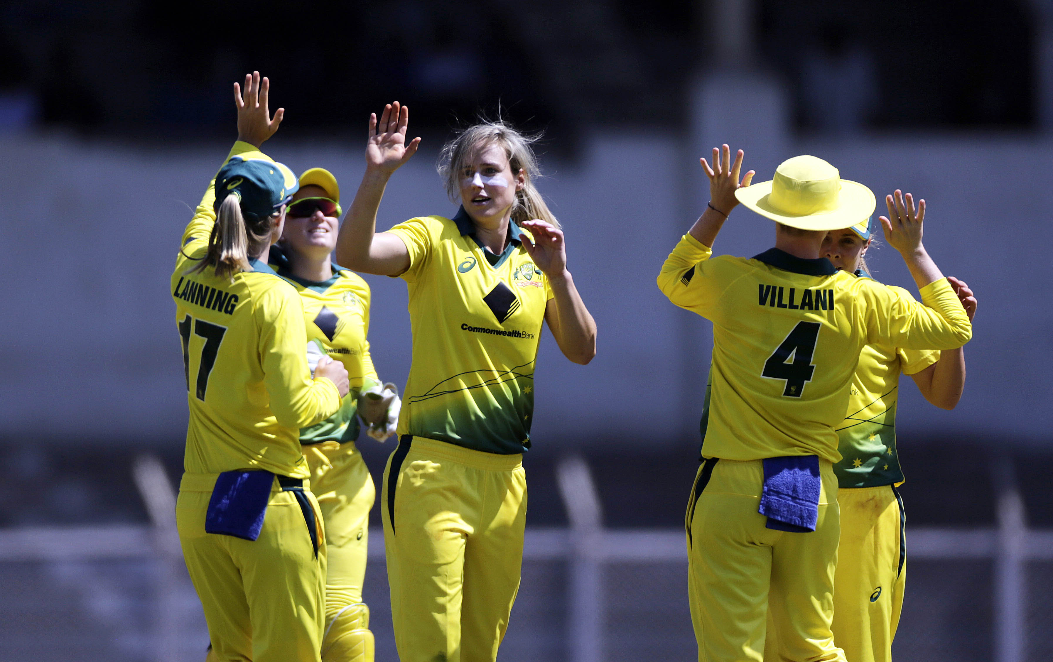 Australia`s Ellyse Perry (center) celebrates after Harmanpreet Kaur`s wicket against India during the Women`s T20 Triangular Series in Mumbai, India on Thursday.