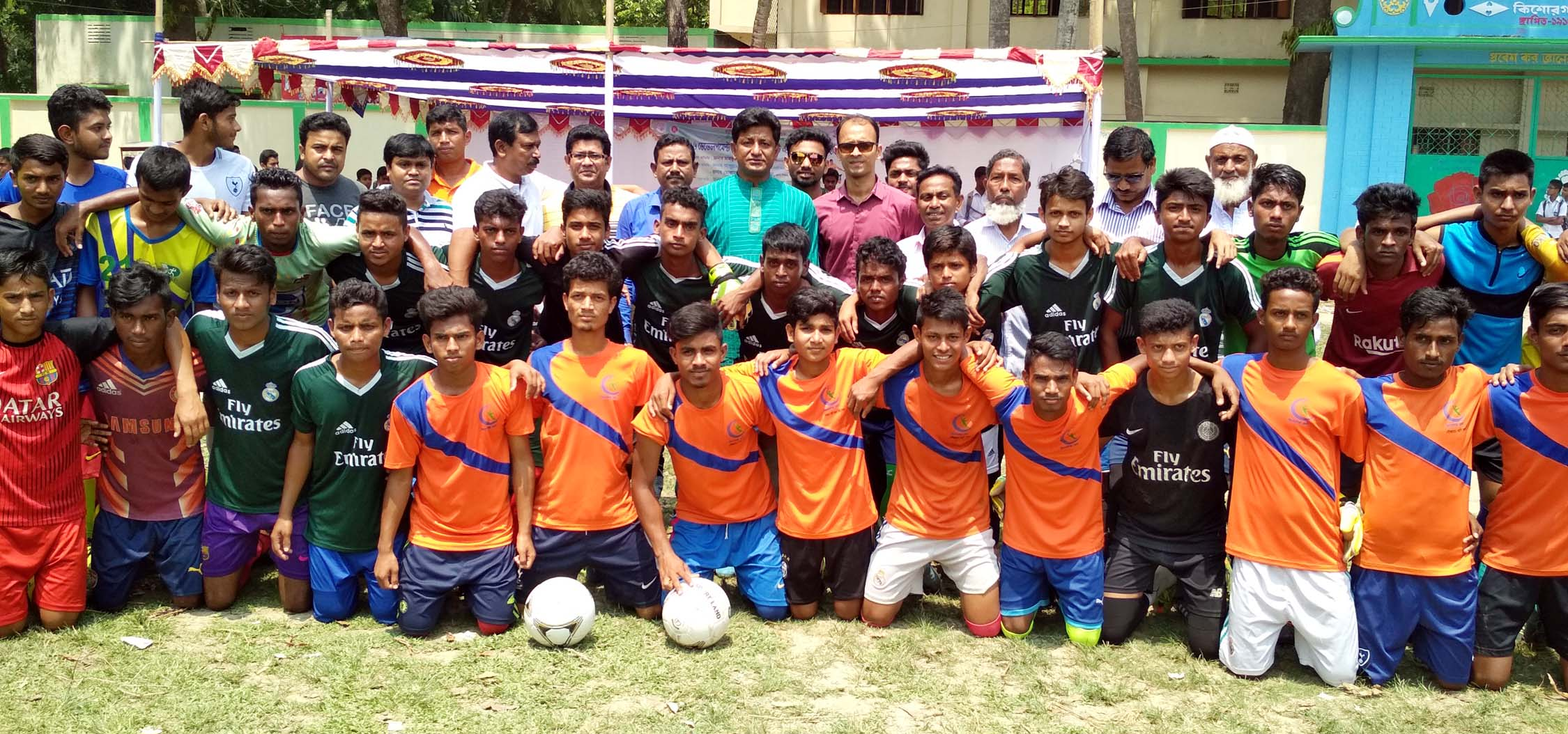 The participants of the selection programme of the Under-16 Development Cup Football Tournament of Kishoreganj District with the chief guest Md Mahmud Parvez, Mayor, Kishoreganj Municipality and the former footballers pose for photo at Azim Uddin High School Ground in Sadar Upazila of Kishoreganj on Tuesday.