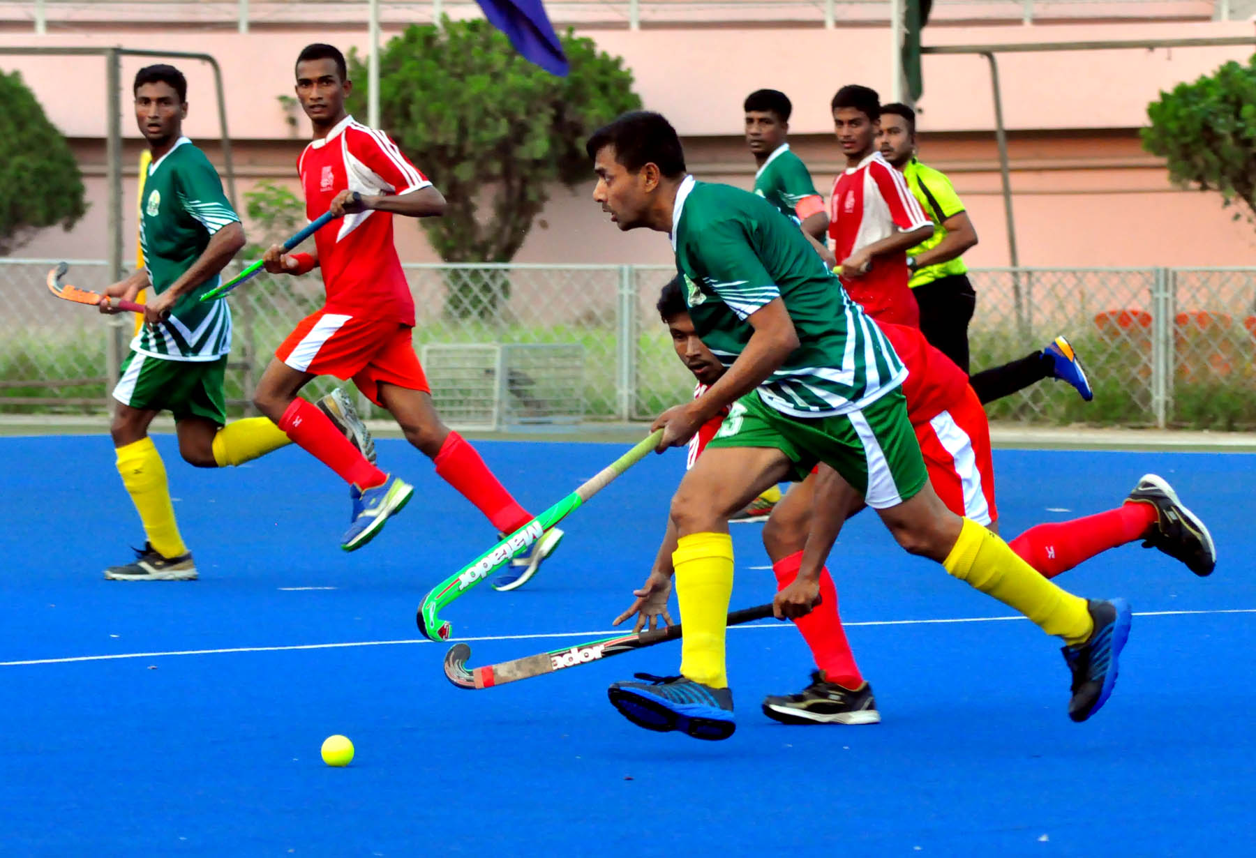 An action from the match of Khaza Rahmatullah Club Cup Hockey between Victoria Sporting Club and Ajax Sporting Club at the Moulana Bhashani National Hockey Stadium on Tuesday.