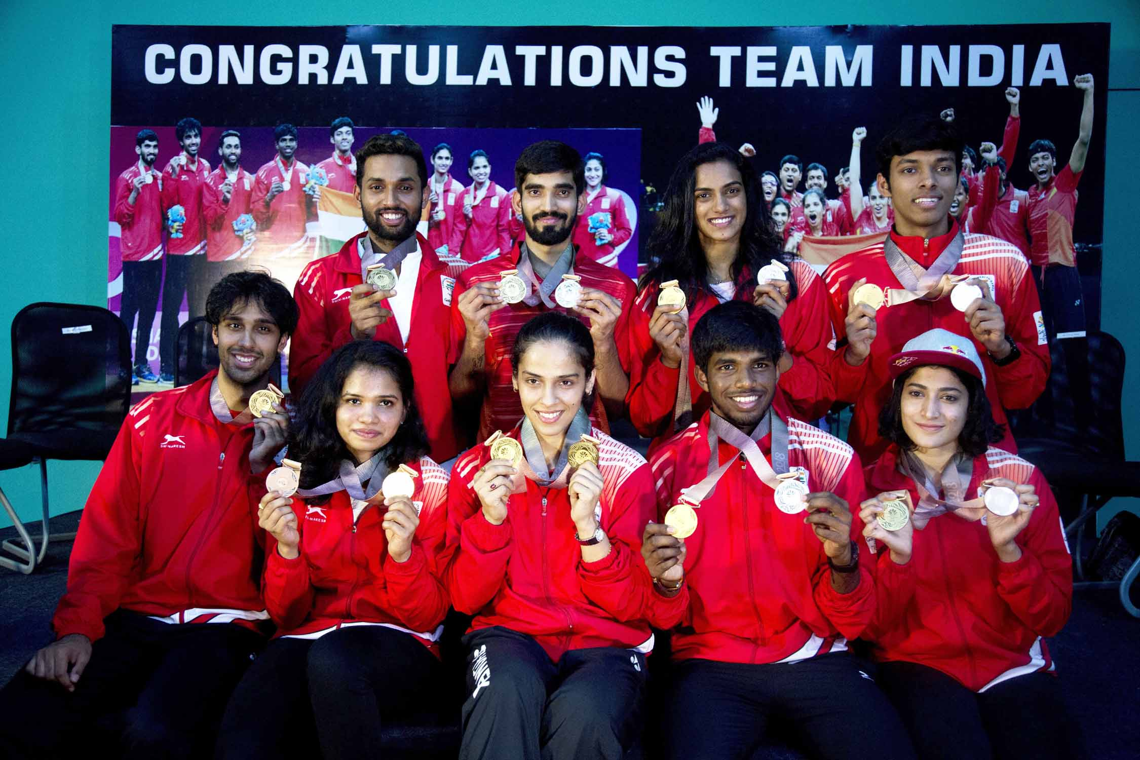 Indian badminton players (from top left) H.S Prannoy, Srikanth Kidambi, P.V. Sindhu, Chirag Chandrashekhar Shetty (from bottom left) Pranaav Jerry Chopra, Sikki Reddy, Saina Nehwal, Satwiksairaj Rankireddy and Ashwin Ponnappa pose for a photograph holding their Commonwealth Games medals during a press conference in Hyderabad, India on Tuesday.