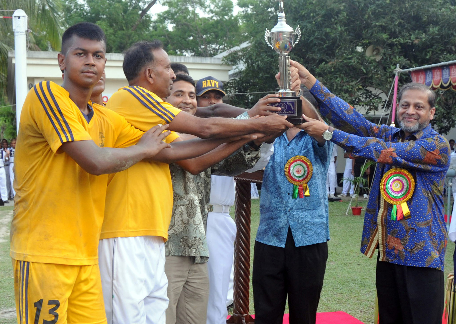 Area Commander of Khulna Naval Region Commodore Shamsul Alam distributes the prize to the BNS Titumir Base, champions of the Inter-Base Volleyball Competition at the Titumir Sports Complex in Bangladesh Naval Ship, Khulna on Wednesday.