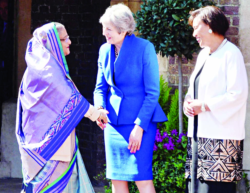 Prime Minister Sheikh Hasina now in London for attending the inaugural function of CHOGM-2018 shaking hands with British Prime Minister Theresa May at Lancaster House on Thursday. Commonwealth Secretary General Patrica Scotland looks on.