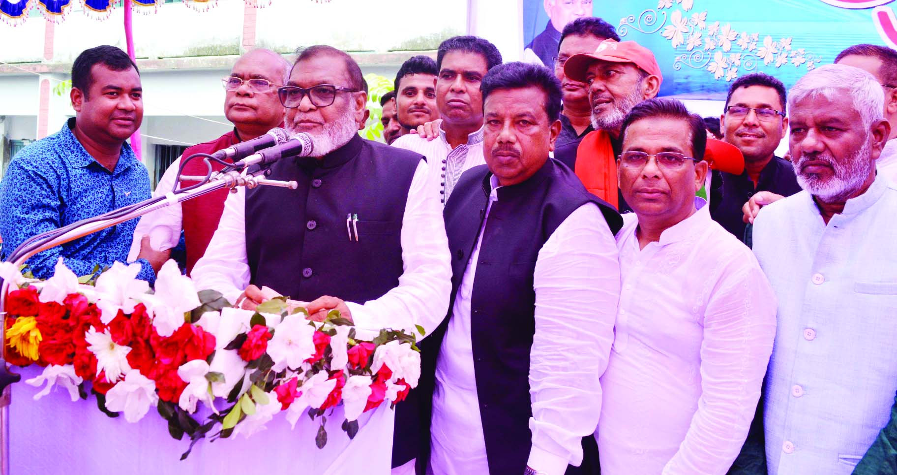 SUJANAGAR (Pabna) : Liberation Affairs Minister AKM Mozammel Haq addressing a public meeting at Shaheed Dulal Pilot Girls' High School ground  as Chief Guest after inaugurating Freedom Fighters' Complex yesterday.