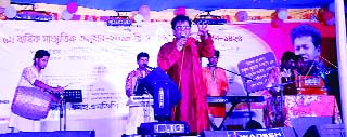 BANARIPARA (Barishal) : Reputed singer Nokul Kumar Biswas rendering songs at the cultural function of Syedkathi SESDP High School on the occasion of Pahela Baishaikh recently.