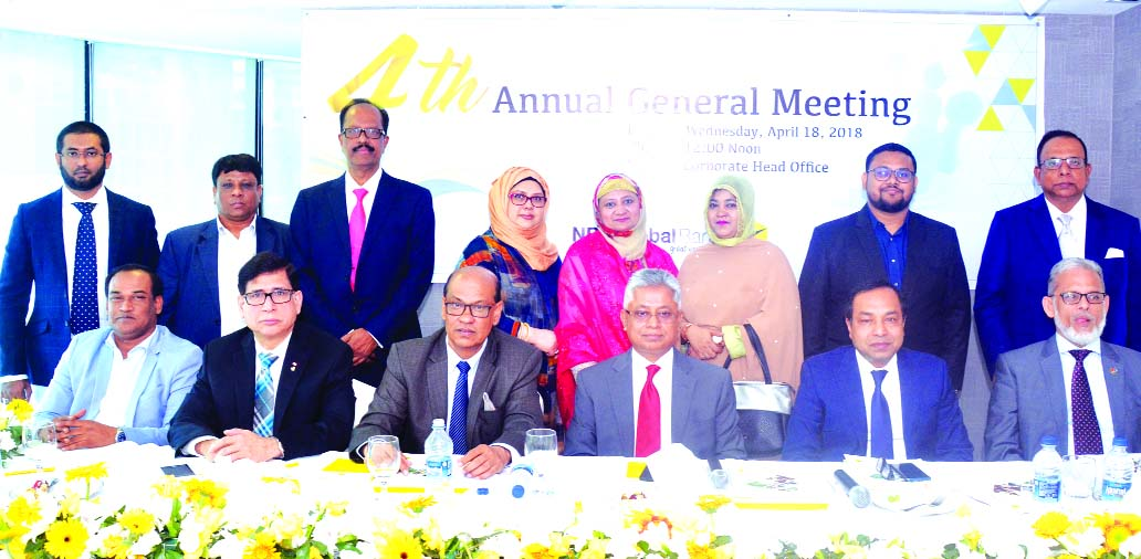 Nizam Chowdhury, Chairman of NRB Global Bank Limited, presiding over its 4th AGM at its corporate head office in the city on Wednesday. Dr. Mohammed Faruque, Arif Ahmed, Osman Gani, Morshedul Alam, Wahidul Alam Seth, Md. Mostain Billah Adil, Danny Chowdhury, Mosammat Shajada Noor Begum, Bourhanul Hassan Chowdhury, Rokea Yesmin, Directors and Proshanta K Halder, Managing Director of the bank among others were also present.