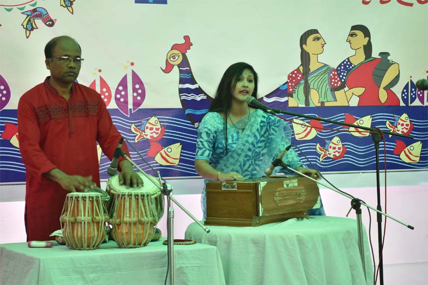 Promising singer Shraban Sharma Biswas rendering songs at the cultural programme organised by the National Press Club on the occasion of 'Pahela Baishakh,' the first day of Bengali New Year 1425.