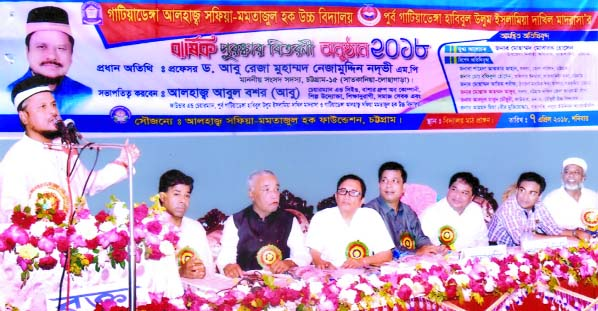 The prize distribution ceremony  of Gatiadanga Alhaj Safia Mamtazul Hoque High School was held recently. Local legislator Prof Abu Reza Md Nizamuddin Nadvi MP seen addressing the function as Chief Guest.