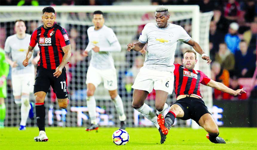 Manchester United`s Paul Pogba (second right) and Bournemouth's Steve Cook battle for the ball, during the English Premier League soccer match between Bournemouth and Manchester United, at the Vitality Stadium in Bournemouth, England on Wednesday.