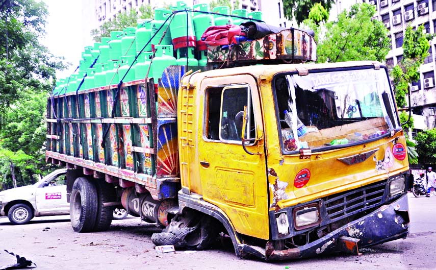 A CNG cylinder laden truck collapses due to tyre burst incidentally saved from disaster occurred in front of the Secretariat in city on Friday.