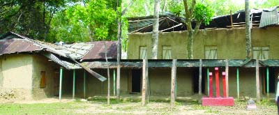BHALUKA (Mymensingh): Bhoraduba  Gilrs' High School  needs immediate repair  which has  been damaged by recent nor'wester . This snap was taken yesterday.