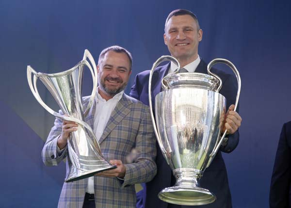 Vitali Klitschko, Mayor of Kiev (right) and Andriy Pavelko, President Ukrainian soccer federation, hold the Champions league trophies at the hand over ceremony in Kiev, Ukraine on Saturday. The Champions League Final is to take place on May 26 at the Olympiyski stadium in Kiev.