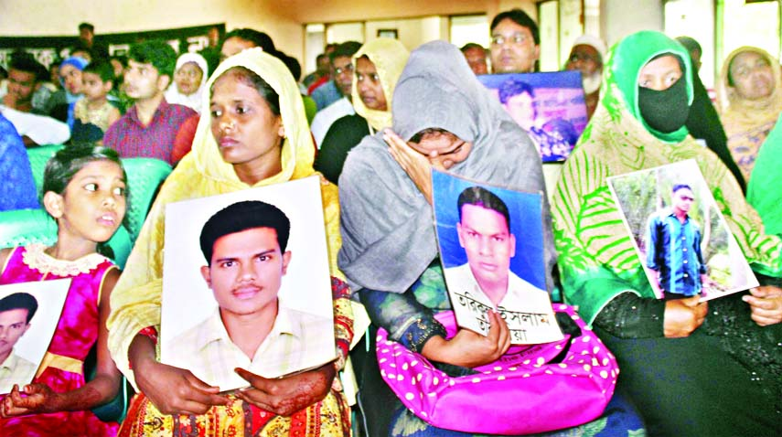 Relatives of persons who disappeared or killed wailing along with the photos of the  victims in front of Jatiya Press Club on Saturday .