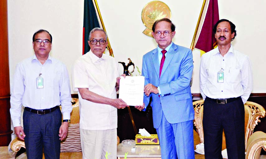 President Abdul Hamid receiving an annual audit report from a delegation led by Auditor and Comptroller General Masud Ahmed at Bangabhaban on Monday.
