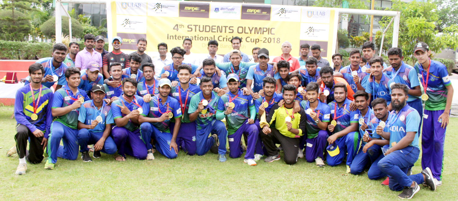 Players and high officials of Students Olympic Indian National Cricket Team (Under 21) and Daffodil International University Cricket Team pose for a photograph  at the Daffodil International University permanent Campus cricket ground on Monday.
