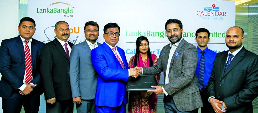 Khurshed Alam, Head of Retail Finance of LankaBangla Finance Ltd (LBF) and Md. Shahriar Zaman, Managing Director of Calendar Tours and Travel Limited, exchanging an MOU signing documents at LBF office in the city recently. Under the deal, LBF card member will enjoy EMI facility up to 12 months on 0 percent interest under ezypay scheme of the agency. Senior officials from both the organizations were also present.