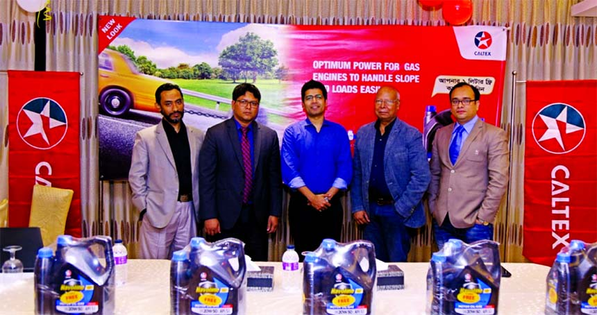 Saiful Islam, Senior Vice-Chairman of Navana Group, poses for a photograph after re-launching the new look package of Havoline Motor Oil Gas 20W 50 SJ with 1Ltr free in Bangladesh at its head office in the city recently. Faisal A Chowdhury, Country Director of Havoline Motor Oil Gas and top management of Navana Petroleum's were also present.