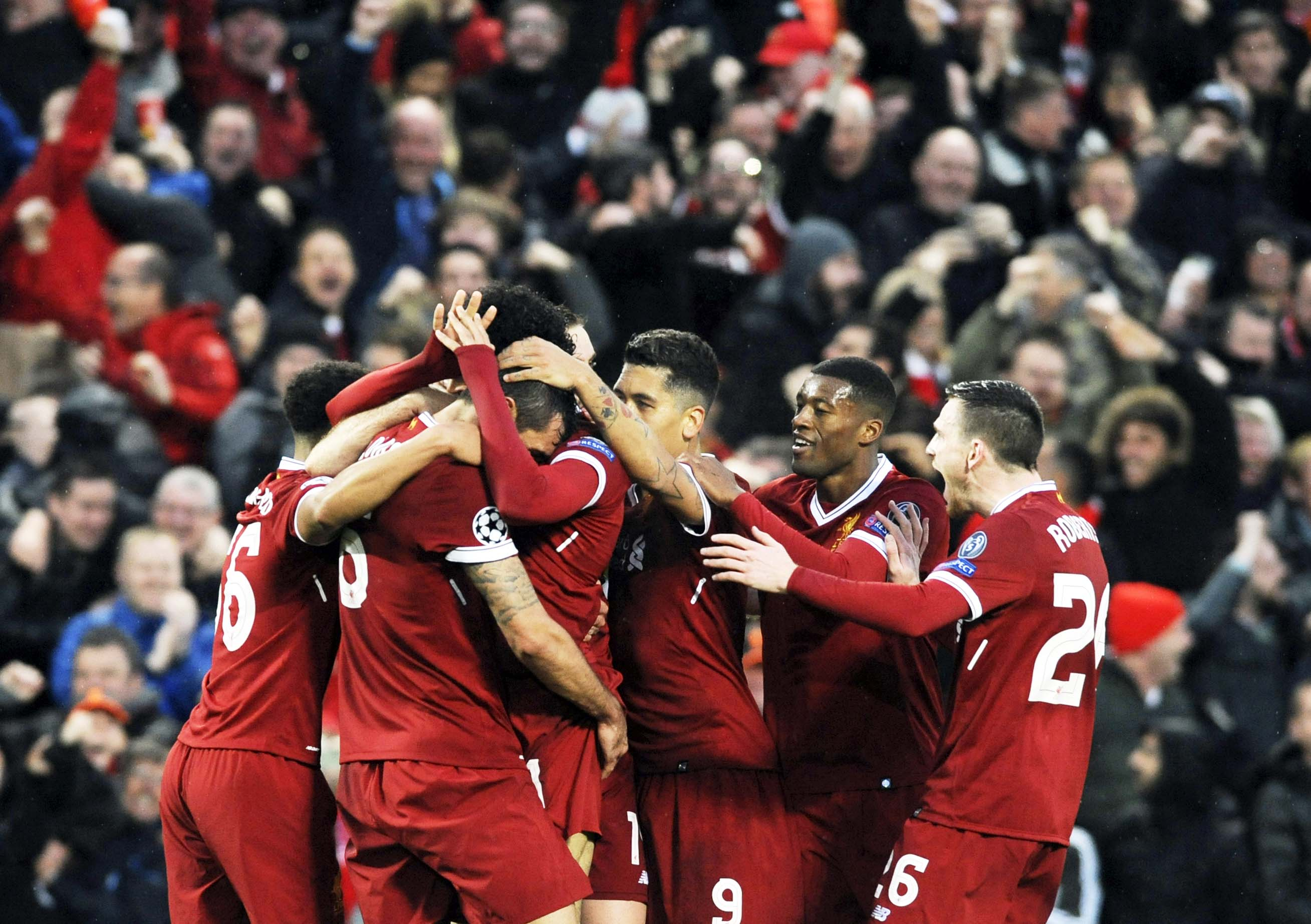 Liverpool`s Mohamed Salah celebrates with teammates after scoring his side's opening goal during the Champions League semifinal, first leg, soccer match between Liverpool and Roma at Anfield Stadium in Liverpool, England on Tuesday.