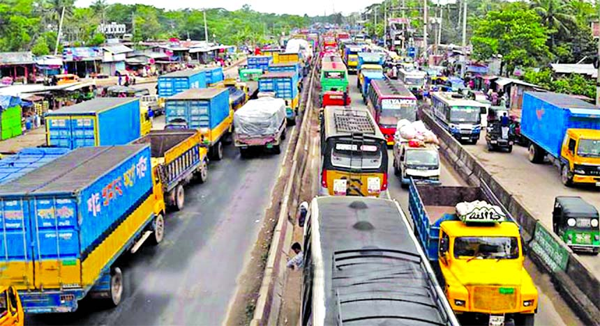 Hundreds of vehicles in a huge traffic gridlock got stuck on Cumilla-Daudkandi Highway on Wednesday, causing immense sufferings to commuters due to traffic mismanagement and road repair work.
