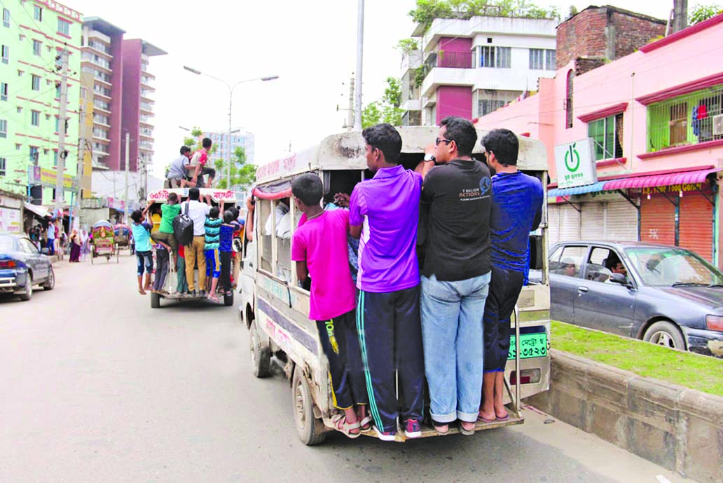 Home-going people availing the 'Leguna service' taking risk of life despite frequent accidents on city roads. This photo was taken from Mohakhali area on Wednesday.