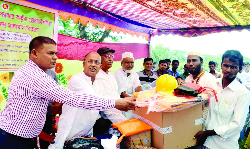 RANGABALI (Patuakhali):   Delowar Hossain, Chairman, Rangabali Upazila and A B M Abdul Manna, Chairman,  Chhotobaishdia Union  distributing  lifejacket, raincoat and helmets among the volunteers  of Cyclone Preparation Programme (CPP)  on Wednesday.
