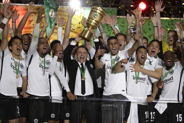 Eintracht coach Niko Kovac celebrates with the trophy after winning the German soccer cup final match between FC Bayern Munich and Eintracht Frankfurt in Berlin, Germany on Saturday.