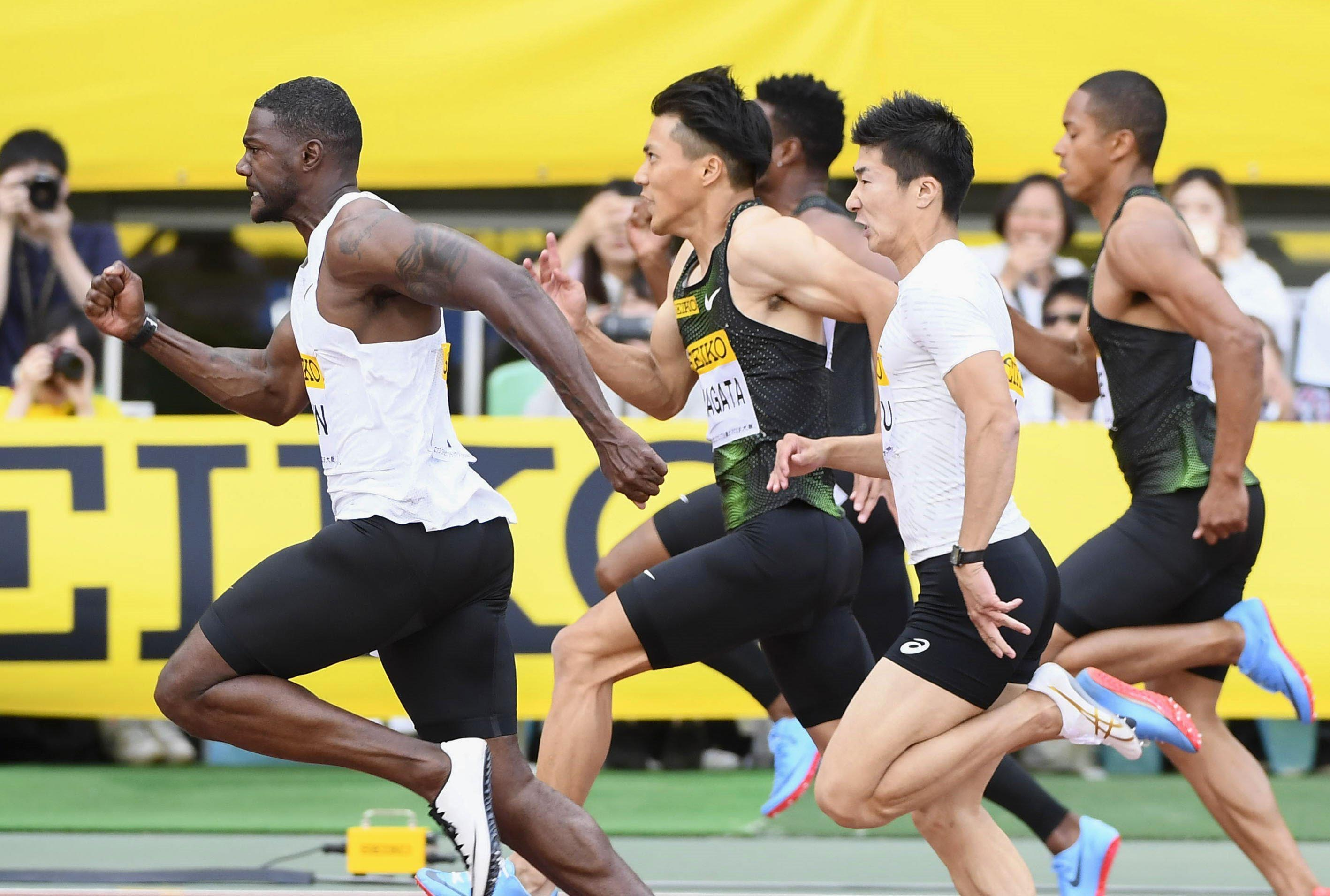Justin Gatlin (left) of the United States competes on his way to winning the men's 100 meters at the Golden Grand Prix track and field event in Osaka, western Japan on Sunday. Gatlin clocked 10.06 seconds to win the 100 meters, ahead of Japan's Ryota Yamagata center.