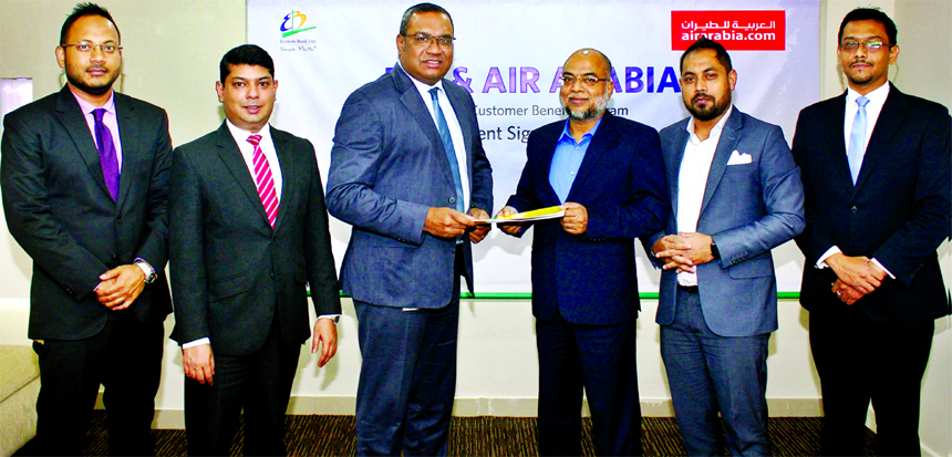 M. Khorshed Anowar, Head of Retail Banking of Eastern Bank Ltd and Md. Abdur Rahim, Director, One World Aviation Limited, General Sales Agent (GSA) of Air Arabia in Bangladesh, exchanging documents after signing an agreement in Dhaka recently. Under the agreement, EBL Cardholders will get up to 35 percent discount on base fare to different popular international destinations.