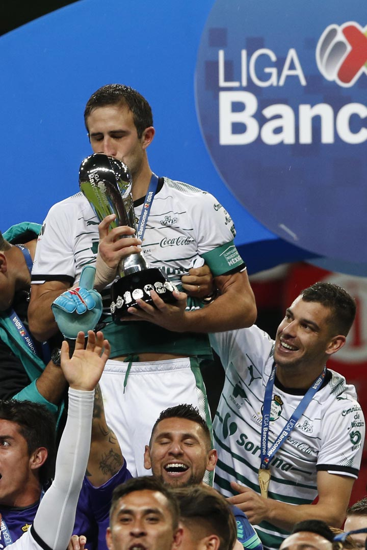 Santos team captain Carlos Izquierdoz kisses the trophy after winning the Mexican soccer league championship against Toluca at Nemesio Diez stadium in Toluca, Mexico on Sunday.