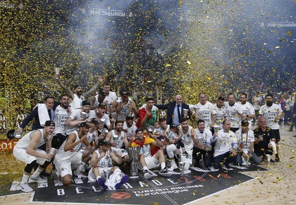 Real Madrid players celebrate as they win the Final Four Euroleague final basketball match between Real Madrid and Fenerbahce Istanbul in Belgrade, Serbia on Sunday.