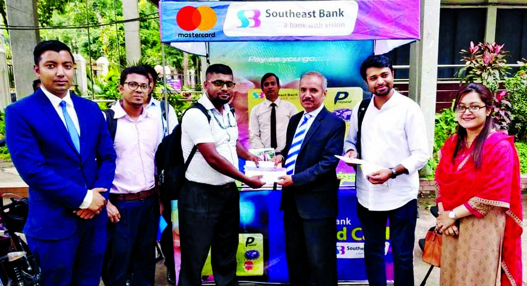 Md. Abdus Sabur Khan, Head of Card of Southeast Bank Limited, inaugurating a 5-day long campaign to issue Prepaid Mastercard to the students of Dhaka University at the campus on Tuesday. During this campaign students of the University would be able to get this dual currency Southeast Bank Mastercard prepaid card instantly.