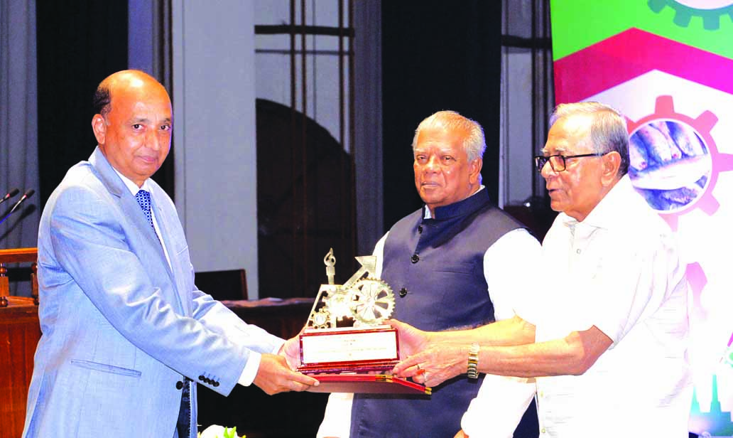 Hafizur Rahman, Chairman of Runner Group, receiving the 'President's Industrial Development Award-2016' from the President Md Abdul Hamid at Osmani Memorial Auditorium on Tuesday.