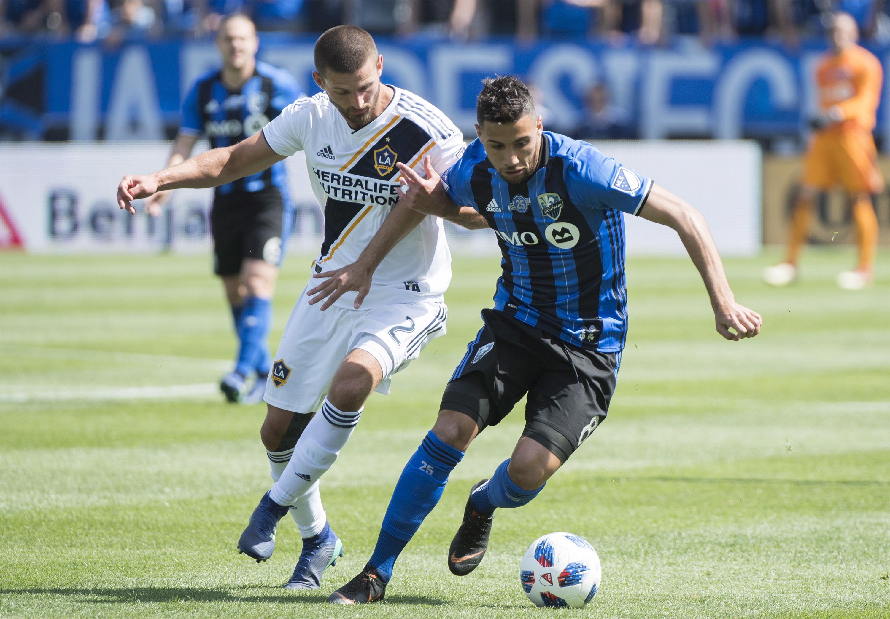 Montreal Impact's Saphir Taider (right) challenges L.A. Galaxy's Perry Kitchen during first-half MLS soccer game action in Montreal on Monday.