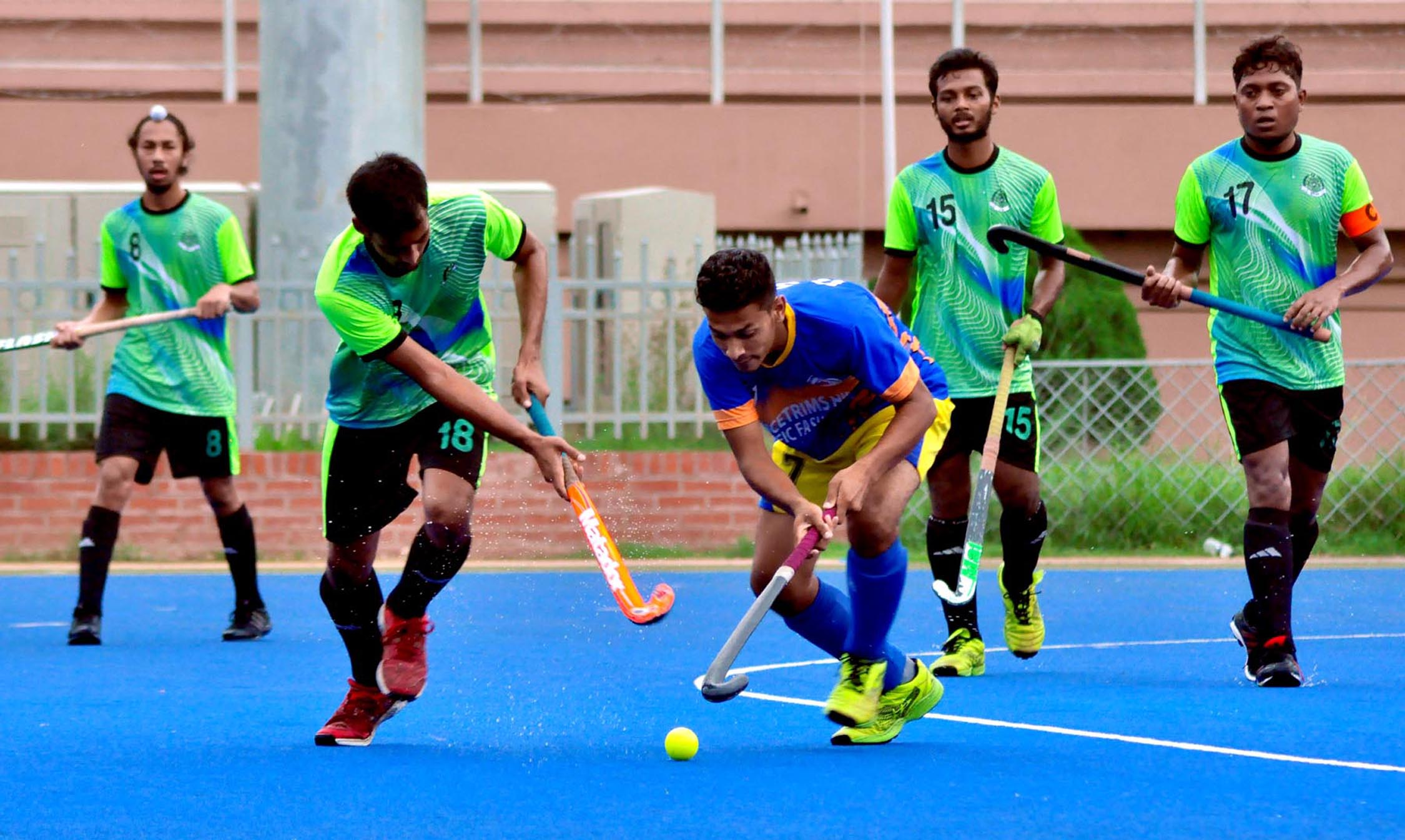 A view of the match of the Green Delta Insurance Premier Division Hockey League between Bangladesh Sporting Club and Dhaka Wanderers Club at the Maulana Bhashani National Hockey Stadium on Tuesday.