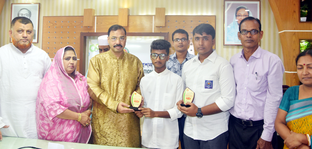 CCC Mayor A J M Nasir Uddin giving crests among the meritorious students  of Pathorghata  Boys' High School  who got GPA-5 in  SSC examination this year on Tuesday.