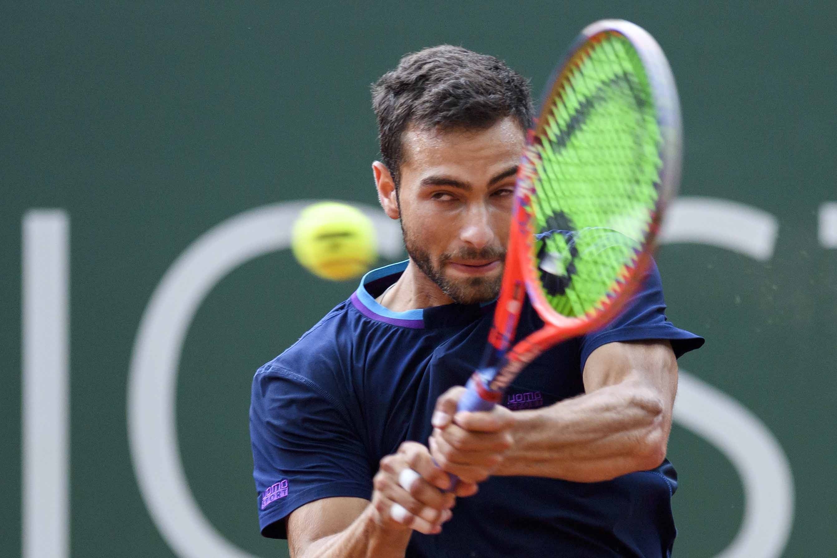 Noah Rubin of the United States returns a ball to Fabio Fognini of Italy during their second round match at the Geneva Open tournament in Geneva, Switzerland on Wednesday.