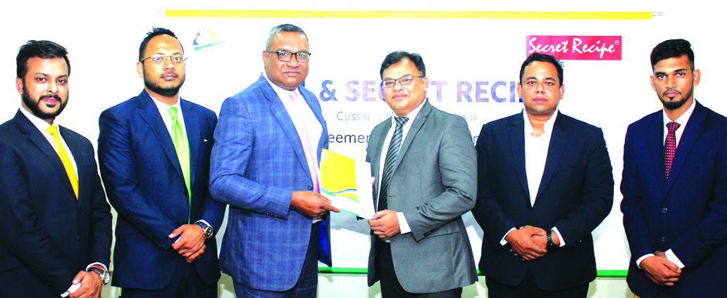 M. Khorshed Anowar, Head of Retail Banking of Eastern Bank Limited (EBL) and KSM Mohith-ul Bari, Head of Business of Pepperoni Limited, the franchise of Secret Recipe in Bangladesh, exchanging an agreement signing documents at its head office in the city recently. Under the deal, cardholders of the bank will get exclusive discounts on food and beverage items at all outlets of the restaurant across the Dhaka city. Senior officials from both the organizations were present.