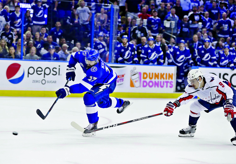 Tampa Bay Lightning left wing Alex Killorn (left) takes a shot as he gets in front of Washington Capitals defenseman Dmitry Orlov during the second period of Game 7 of the NHL Eastern Conference finals hockey playoff series on Wednesday.